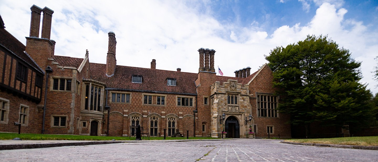 Photo of Meadow Brook Hall, a large historic brown brick building.