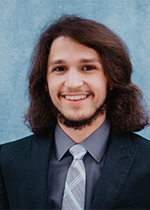 A head shot of Joshua, business honors student