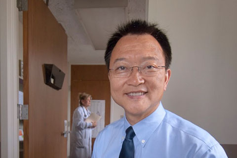 Ziaodong Deng, Ph.D., in a doctor's office