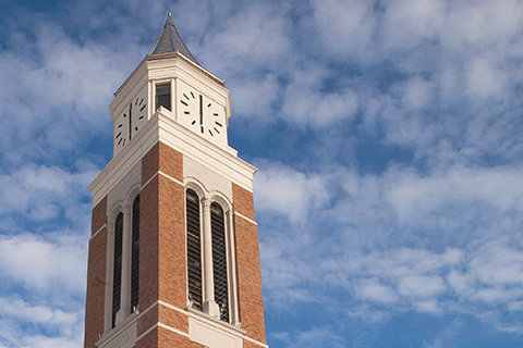 A photo looking up a Elliott Tower on Oakland University's campus.