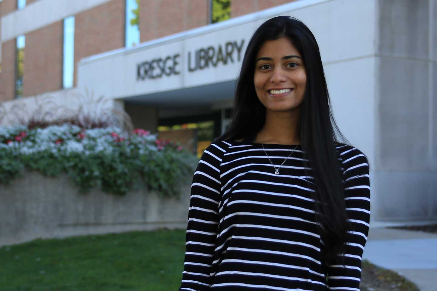 Naveena in front of the library