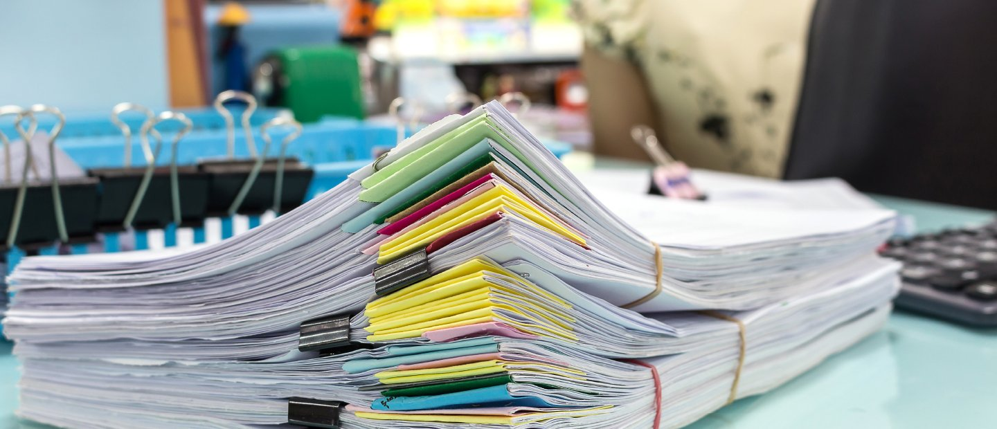 Piles of paper with colorful page markers