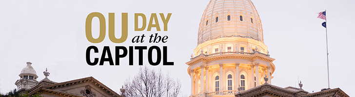 "image of the top of the State of Michigan capitol building with the text ""OU Day at the Capitol"""