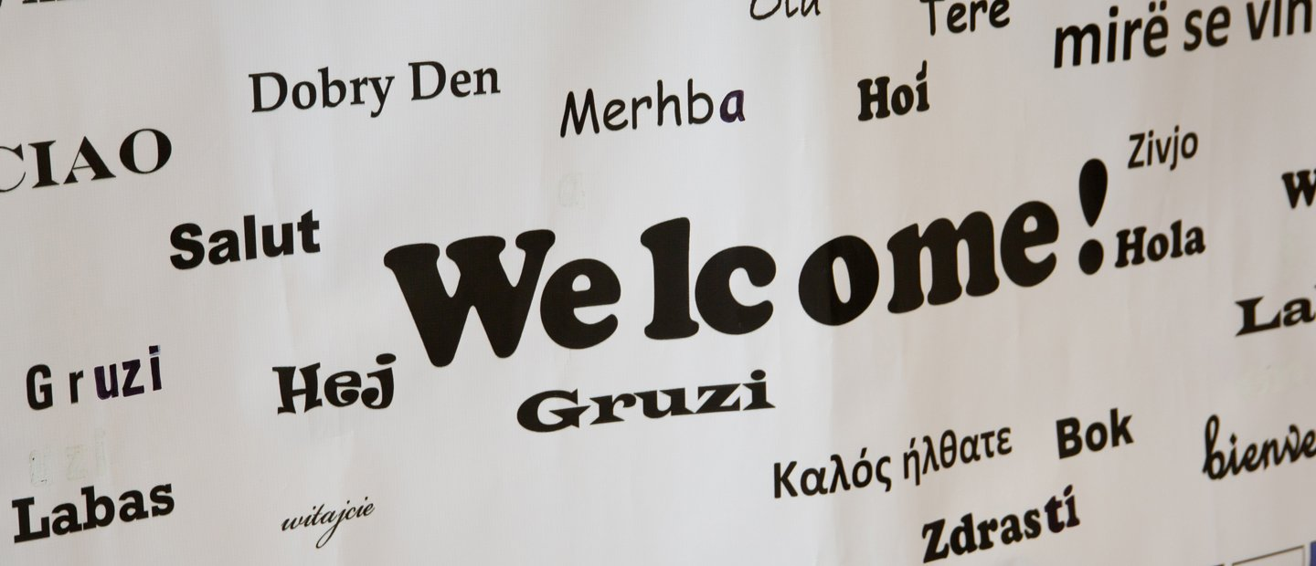 a sign that says Welcome! in English and many other languages