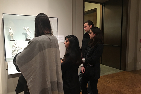 students observing white sculptures in a glass case at the Detroit Institute of Art