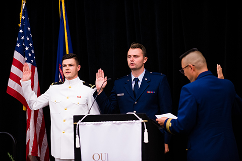 Recent medical student graduates, Dr. Kyle Eaton and Dr. Scott Myers earn their military promotion during Honors Convocation