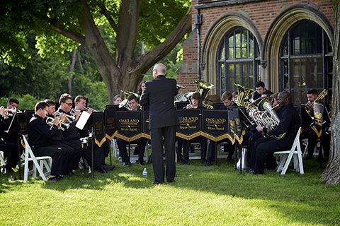 O U brass band performing outdoors by Meadow Brook Hall