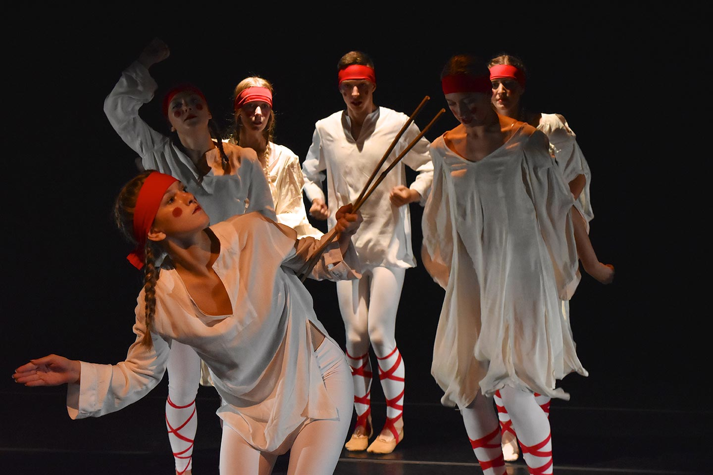 O U dance students perform The Rite of Spring in white robes with red headbands