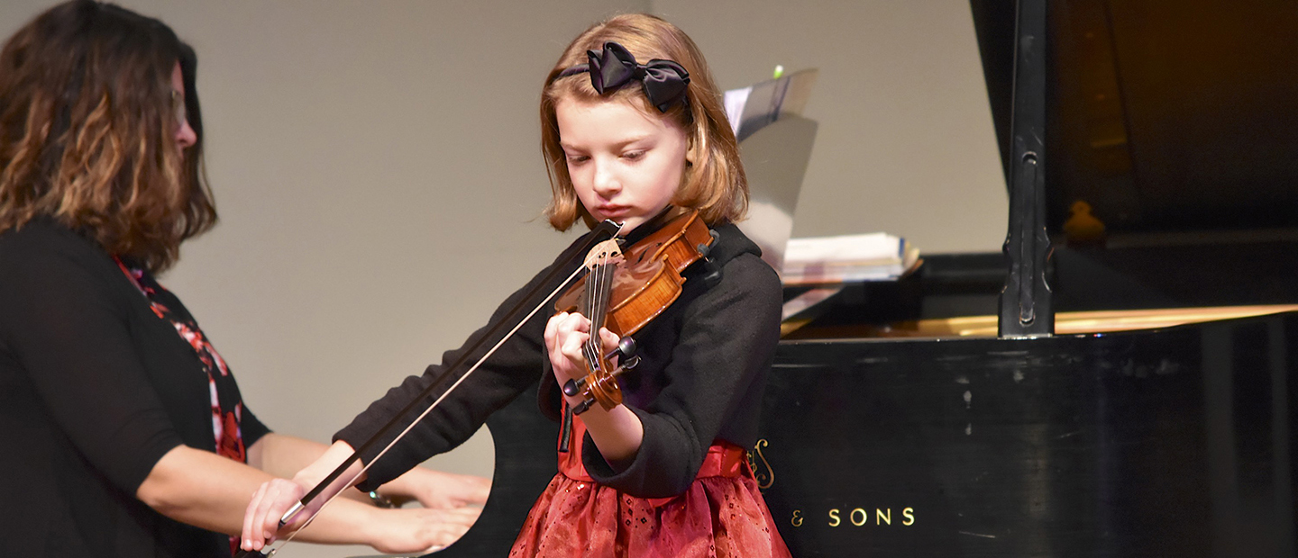 image of a young girl playing a violin
