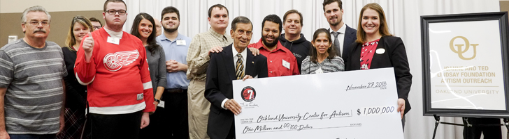 OUCARES participants and administration accepting $1,000,000 check from the Ted Lindsay Foundation