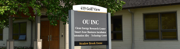 """OU Inc building with sign, text on sign reads """"419 Golf View OU INC Clean energy Research Center Smart Zone Business Incubator, Automation Alley, Technology Center, Meadow Brook Estate"""
