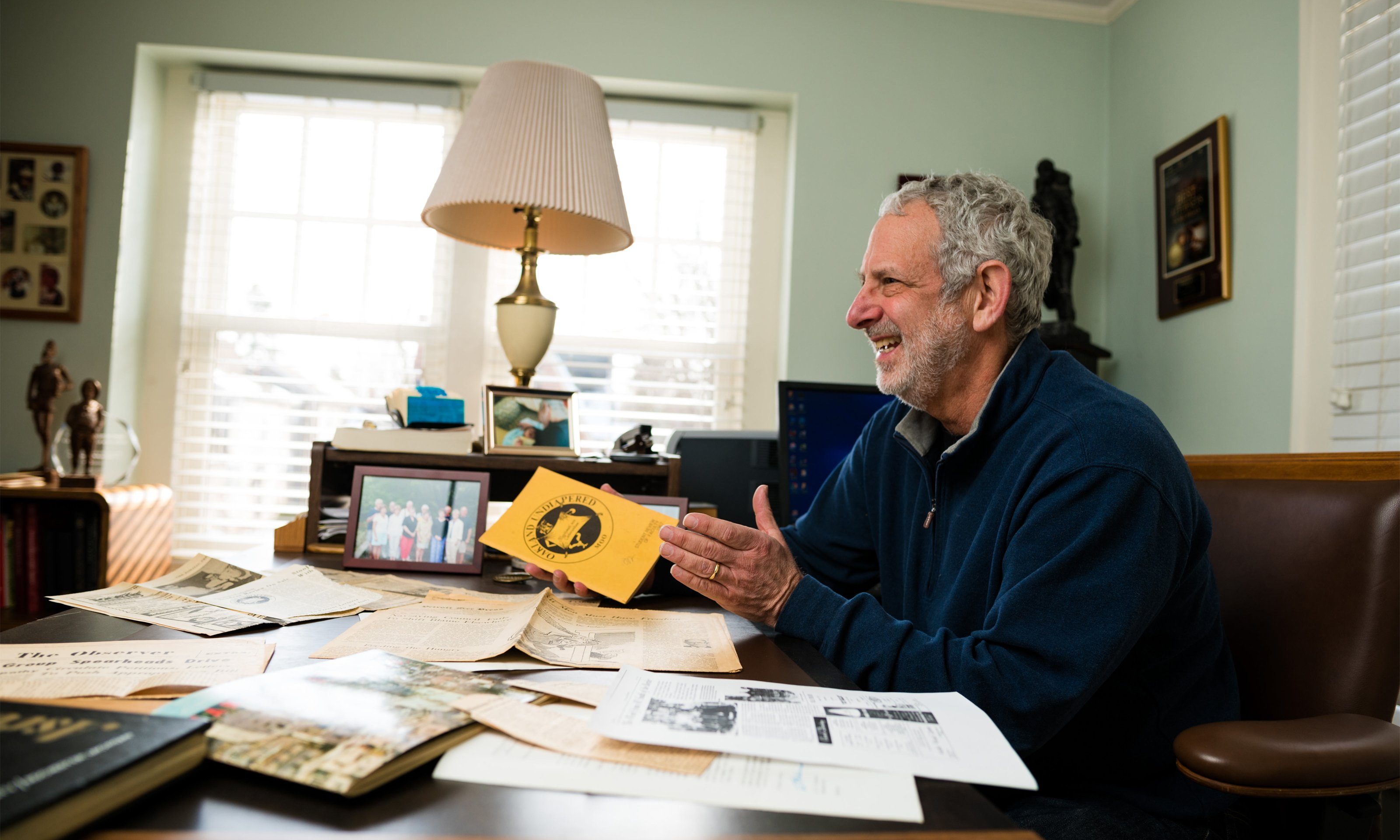 Oakland University alumnus Marty Reisig looks over papers from his days as a student