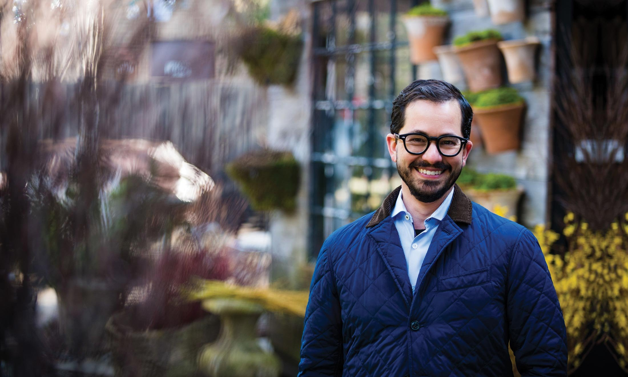 Phillip Morici outside at the fleurdetroit design campus - Plants in the background