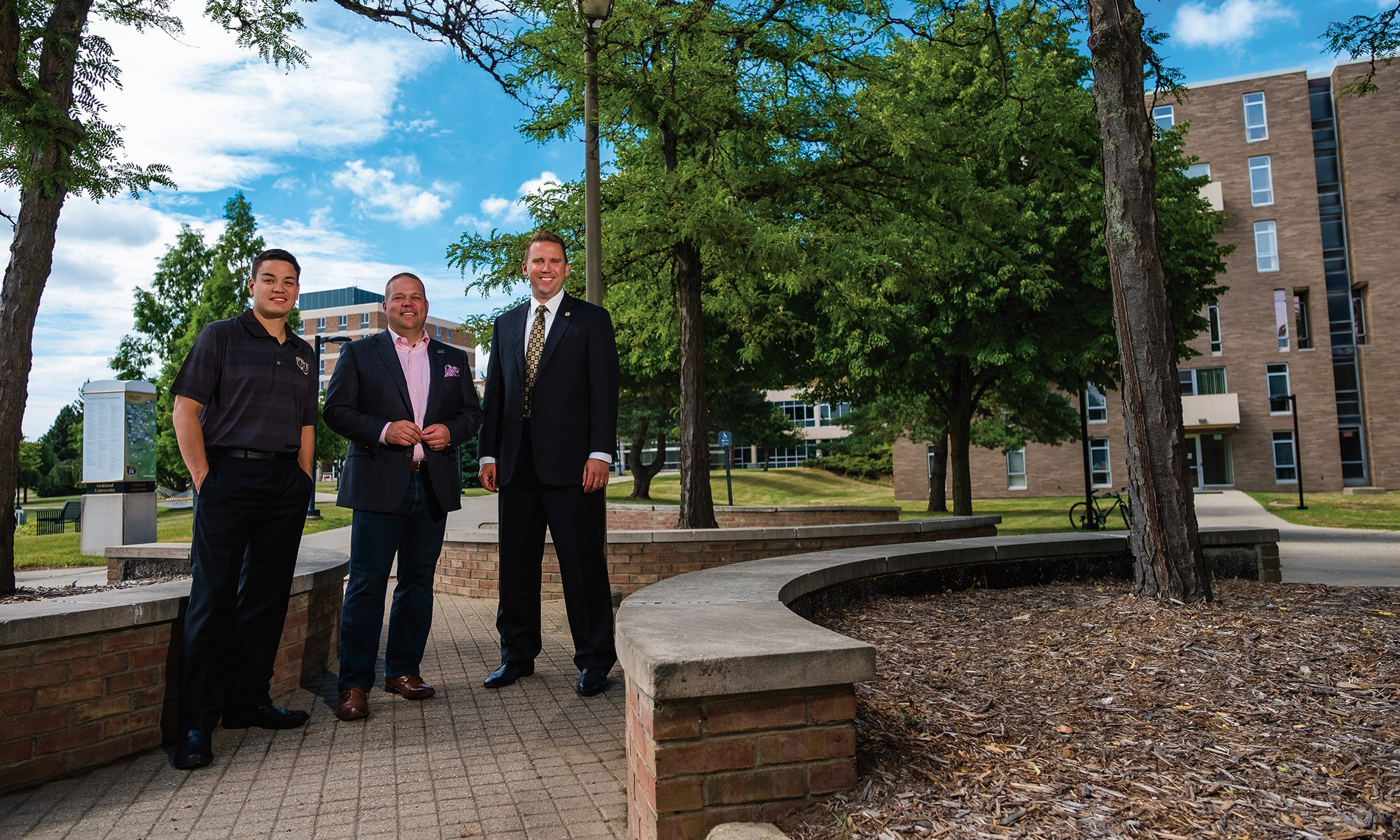 Mayor Rob Ray of Auburn Hills, Mayor Bryan Barnett of Rochester Hills  and Mayor Kevin McDaniel of Rochester stand together on OU's campus.