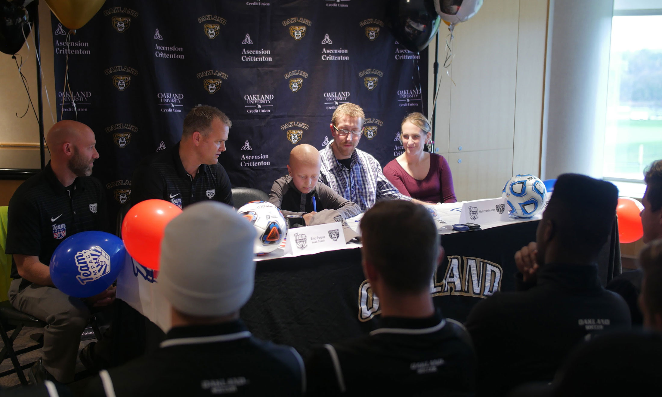 Alex VanHolder in the Oakland University Athletics Department's press room signing a letter of intent with the men's soccer team