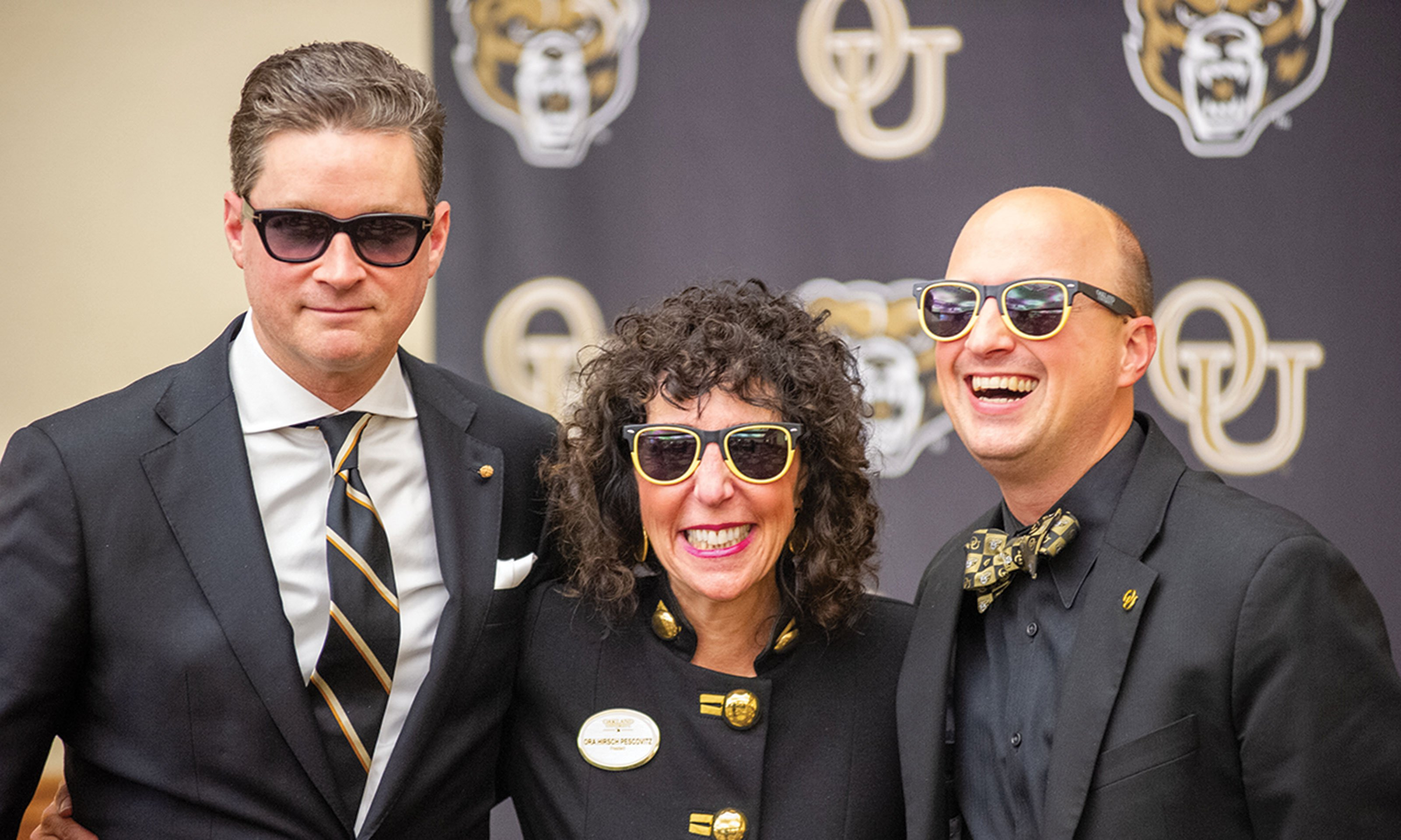 OU President Ora Hirsch Pescovitz poses with two people