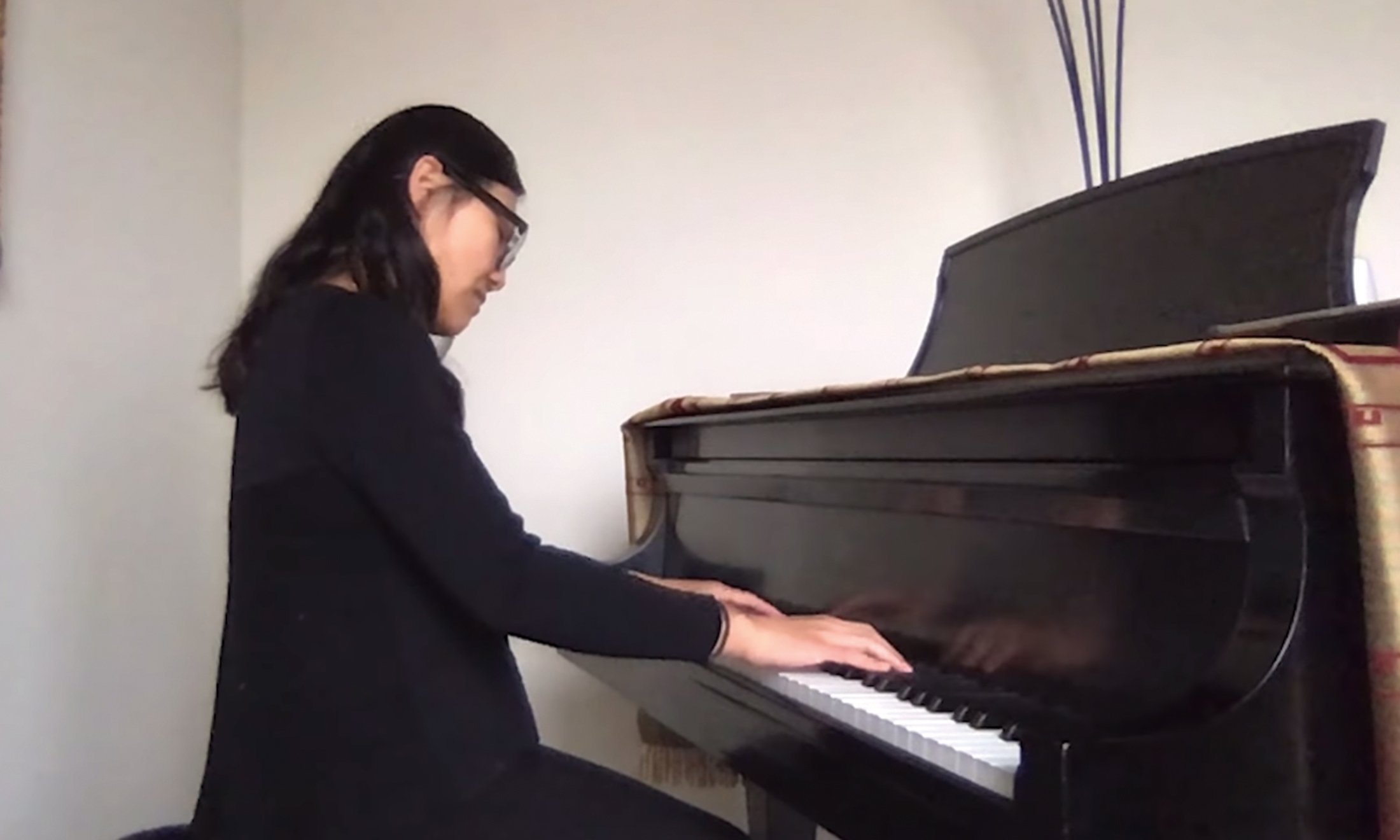 A woman playing the piano.