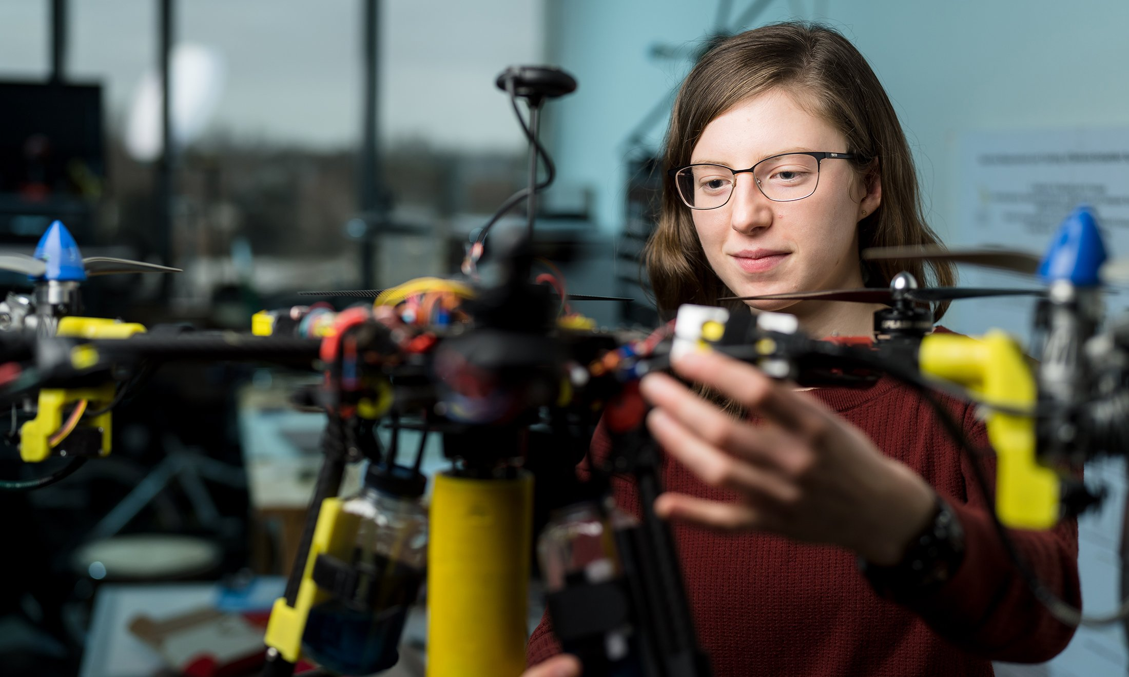 A woman working on a drone.