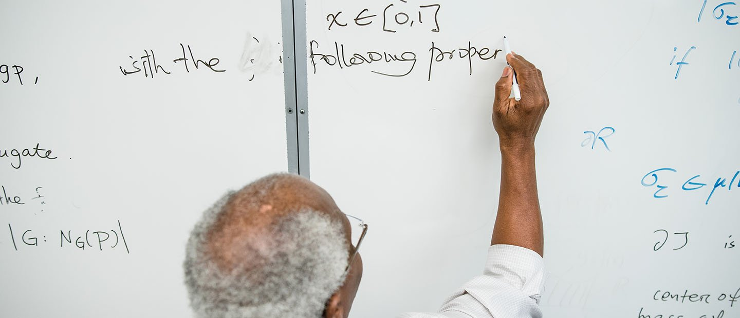 professor writing on a white board