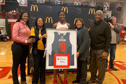 7b25cde0a8ea 2019 McDonald s All American- Rickea Jackson. young woman holding a framed  basketball jersey