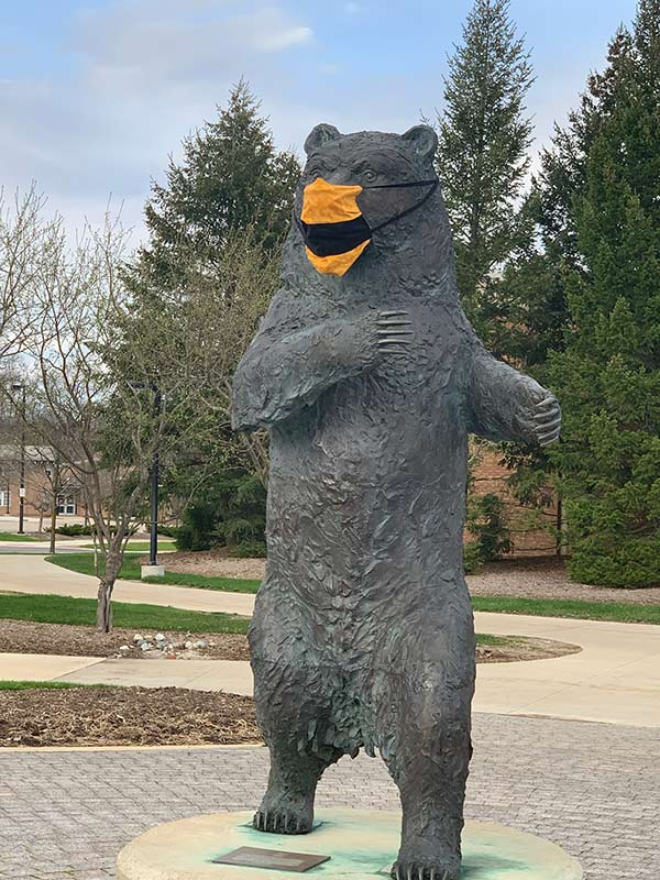 Grizz Statue following the safety guidelines and wearing a mask for others protection.