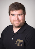 Headshot of Kurt Kirkpatrick in a black Oakland University shirt
