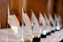 image of a row of trophies on a table