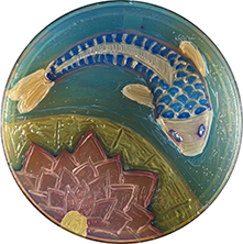 image of a ceramic work of art that's circular with a fish on it