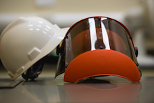 image of two safety helmets — one white and one orange