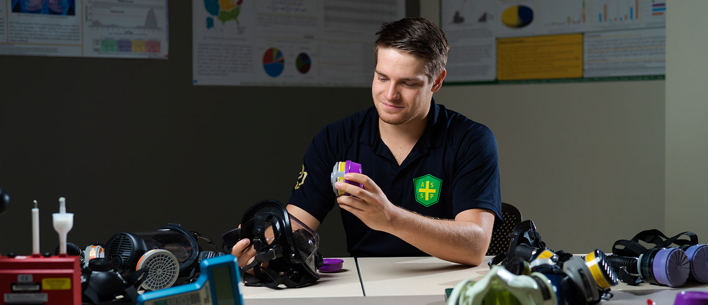 image of Ryan Papiernik working with environmental health and safety devices in a classroom