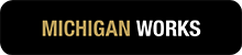 "black button with ""Michigan Works"" in gold text"