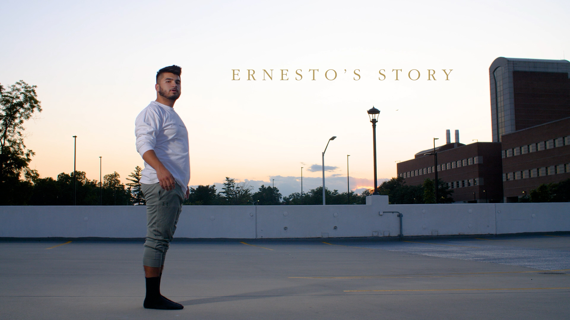 Ernesto Duran-Gutierrez posing for a photo outside on O U campus at sunset. Text on the image reads Ernesto's story.