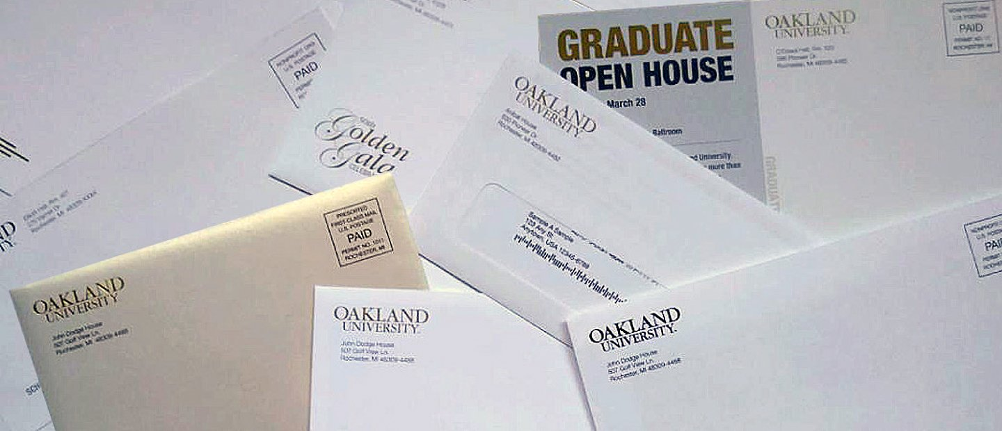 A photo collage of various mail pieces from Oakland University.
